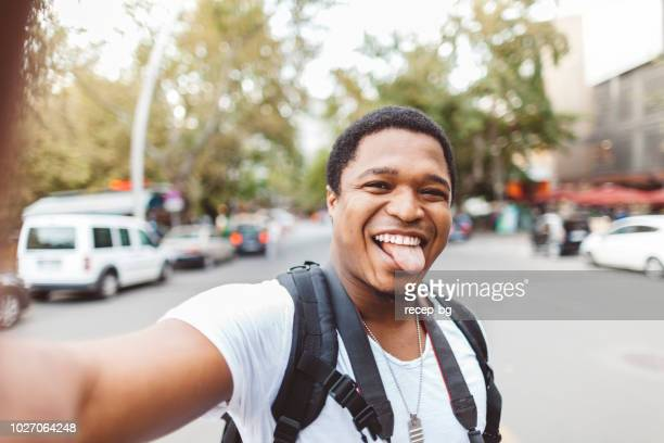 young african tourist taking selfie during his travel - august stock pictures, royalty-free photos & images