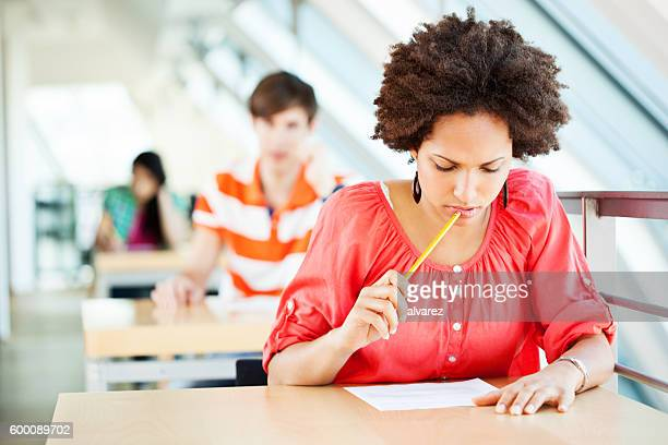 Young african woman at an exam