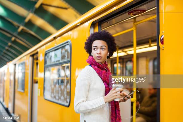 Young african woman boarding a train