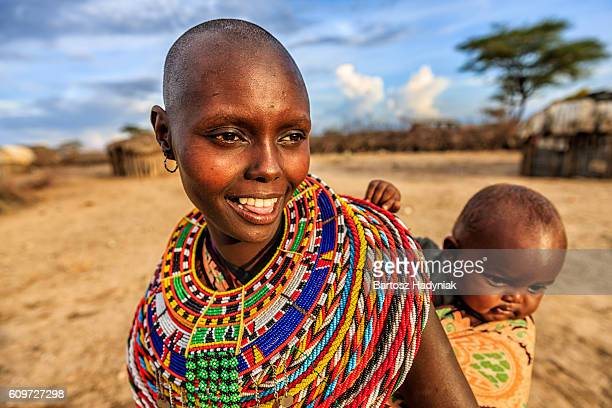 Young African woman carrying her baby, Kenya, East Africa
