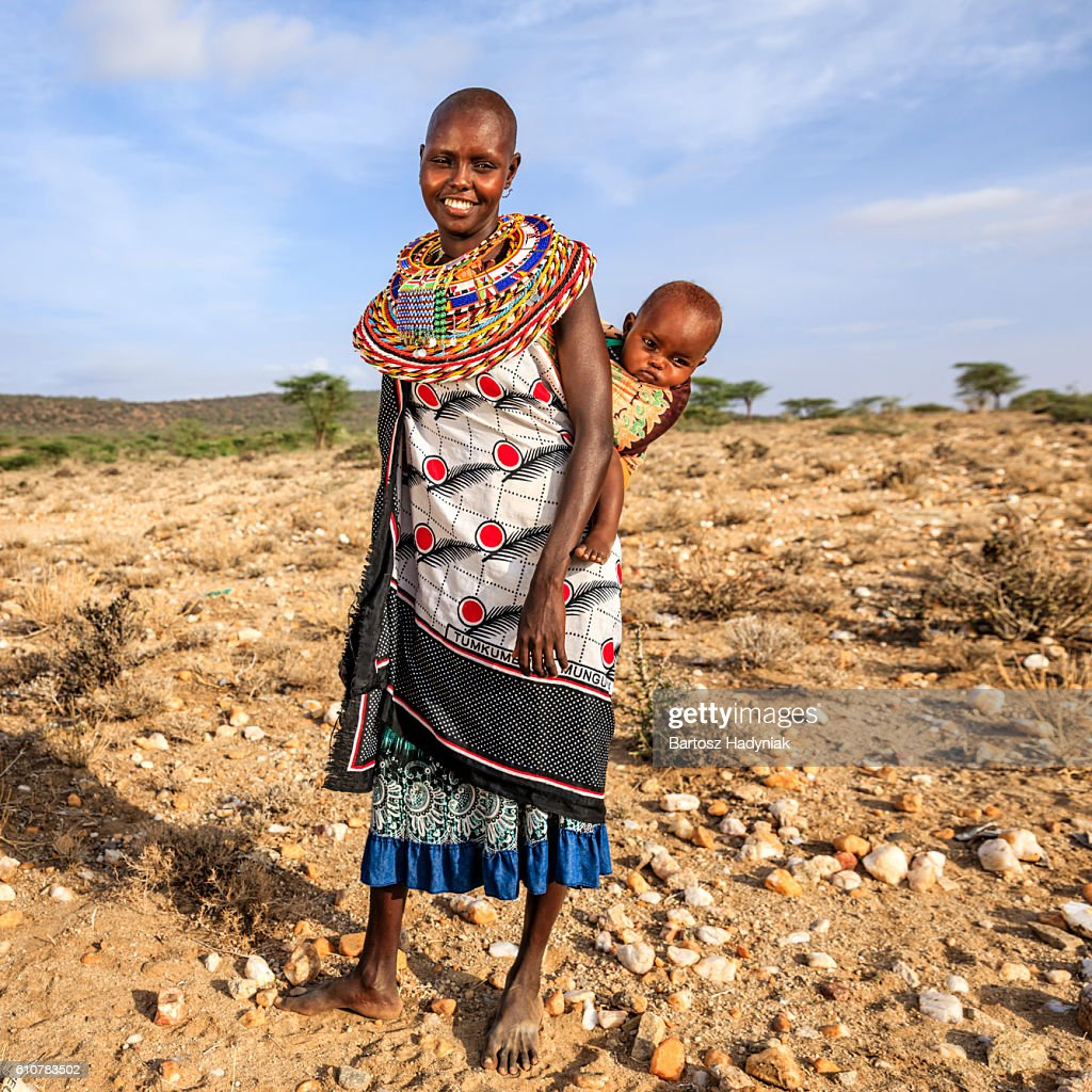 Young African woman carrying her baby, Kenya, East Africa : Stock Photo