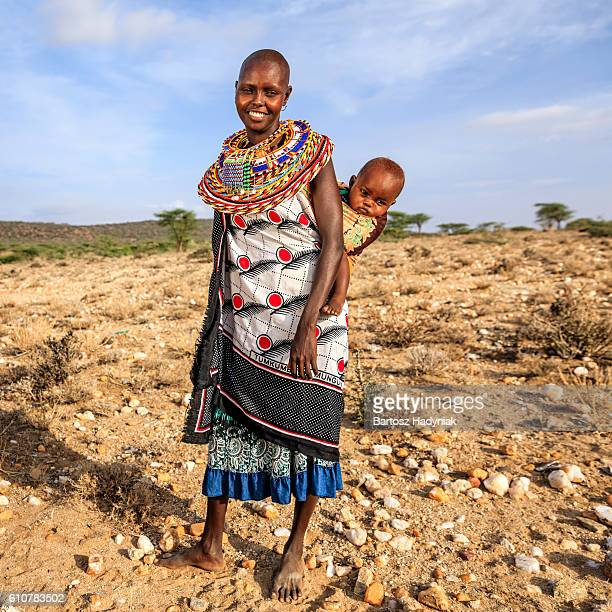 young african woman carrying her baby, kenya, east africa - native african girls stock photos and pictures