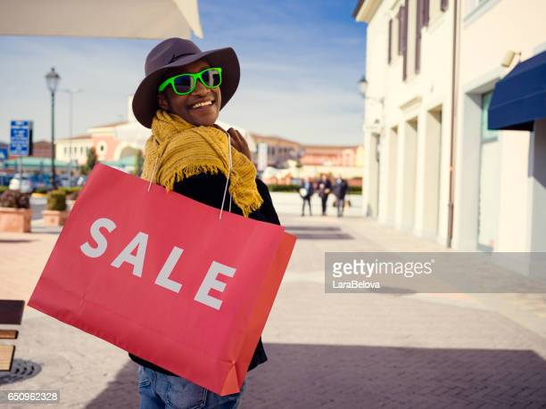 Young African woman during shopping day