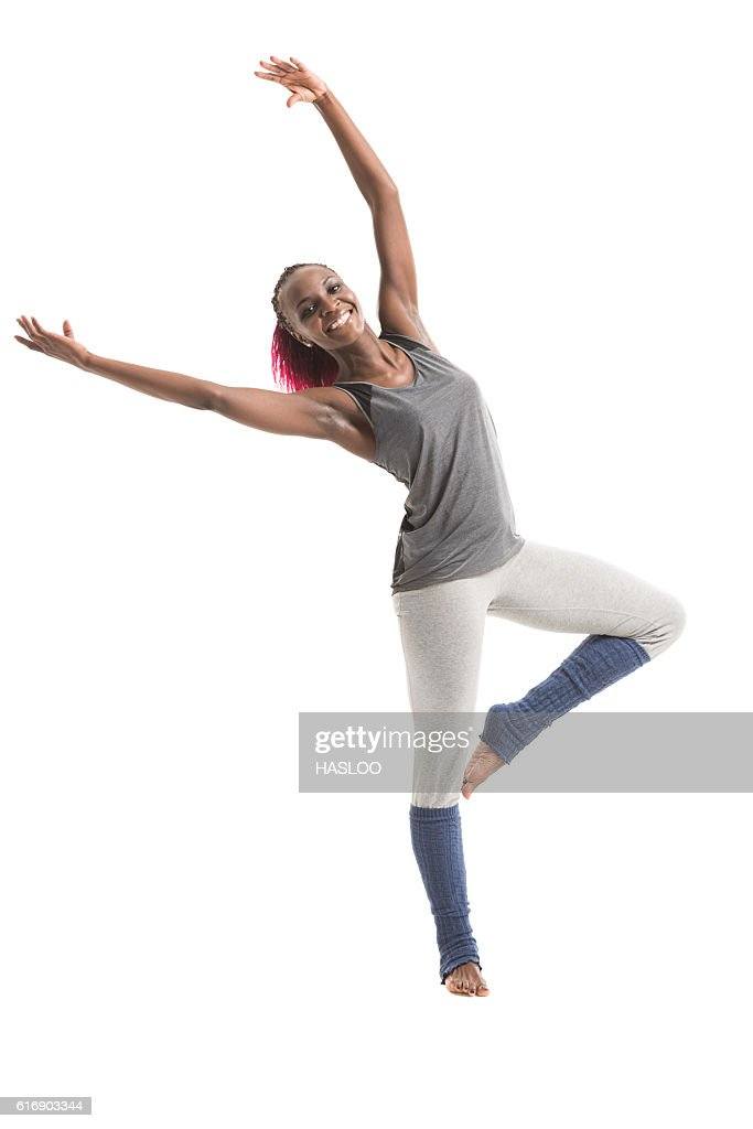 Young african woman practicing dancing : Stock Photo