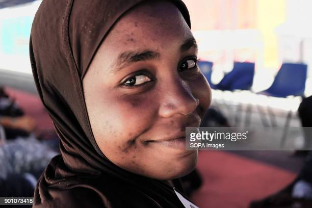 A young african woman seen smiling after being rescued as about 1500 african refugees land in Naples from Vos Prudence a rescue boat of Medecins Sans...