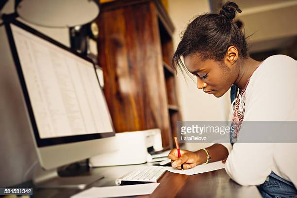 Young African woman studying home