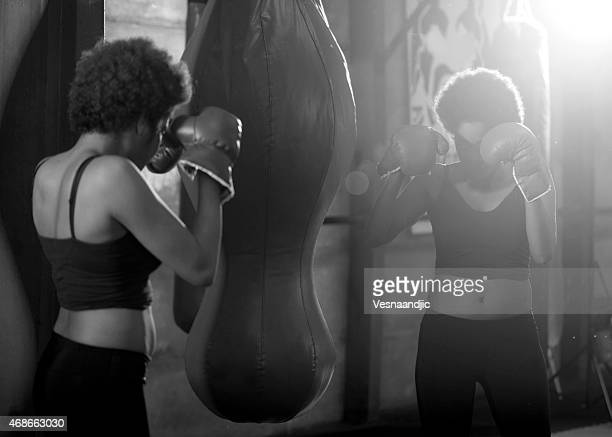Young african woman training at gym