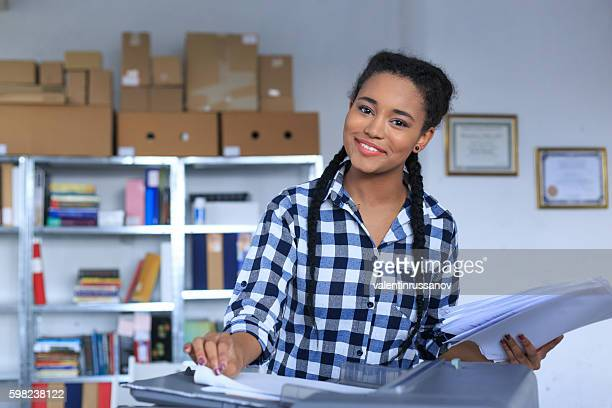 Young african woman using a photocopier