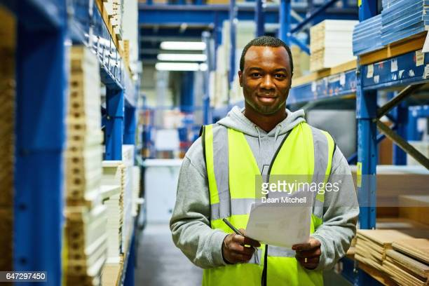Young african worker working in factory
