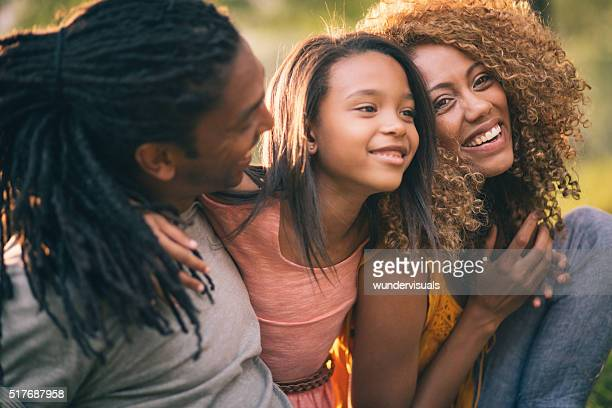 Young African-American family laughing and smiling with their cu