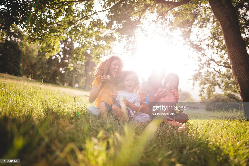 Young african-american family spending quality family time in pa : Stock Photo