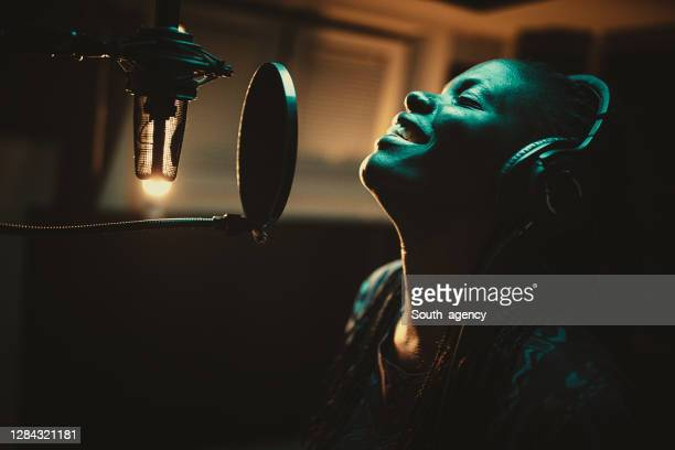 young african-american female singer recording song in the music studio - recording studio stock pictures, royalty-free photos & images