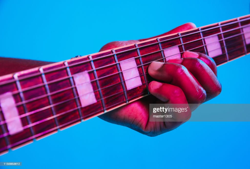 Young african-american jazz musician playing the guitar : Stock Photo
