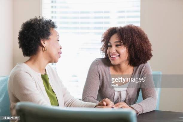 Young African-American woman conversing with her mother