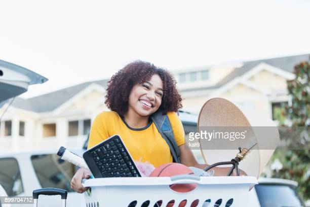 young african-american woman moving house - unpacking stock pictures, royalty-free photos & images