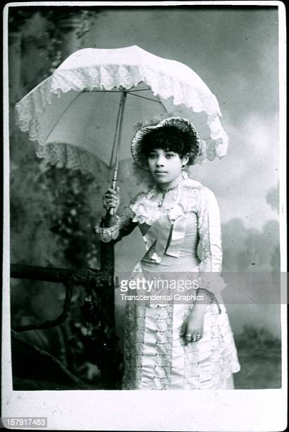 A young AfricanAmerican woman of great wealth poses for a cabinet photo around 1885 in Detroit Michigan