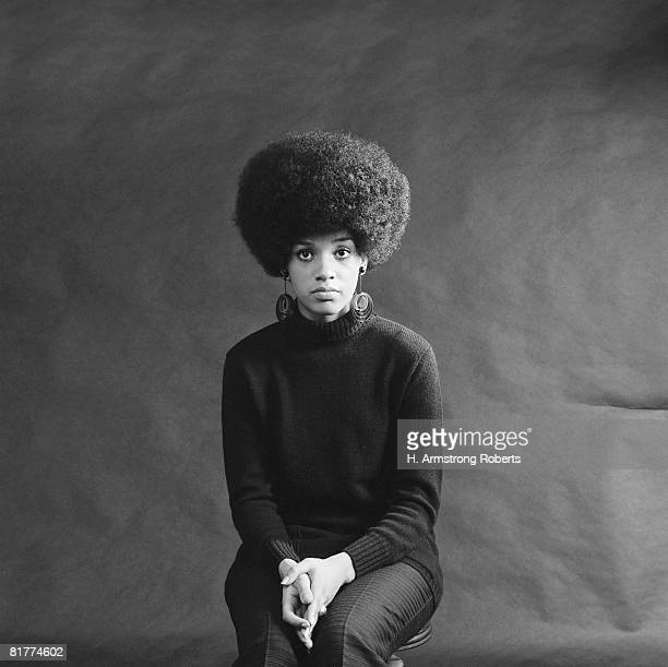 young african-american woman with afro, looking sad. - afro americano foto e immagini stock
