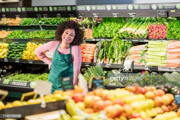 young african-american woman working in grocery store - supermarket stock pictures, royalty-free photos & images