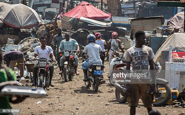 Young Africans are riding motorcycles on the biggest electronic scrap yard in Agbogbloshie a district in Ghana's capital on September 09 2016 in...