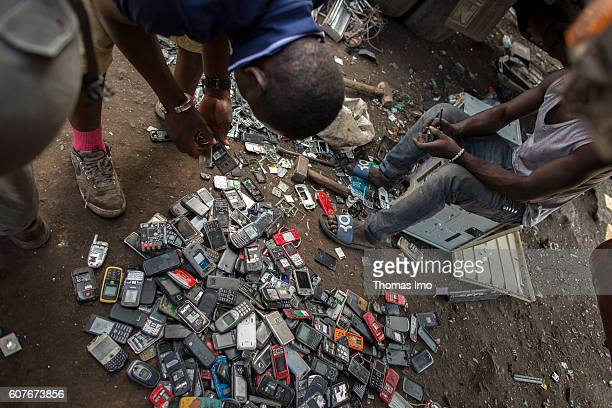 Young Africans disassemble old mobile phones on the largest electronic scrap yard of Africa in Agbogbloshie a district of Ghana's capital on...
