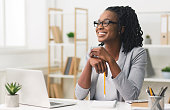 Young Afro Business Lady Smiling Sitting In Modern Office