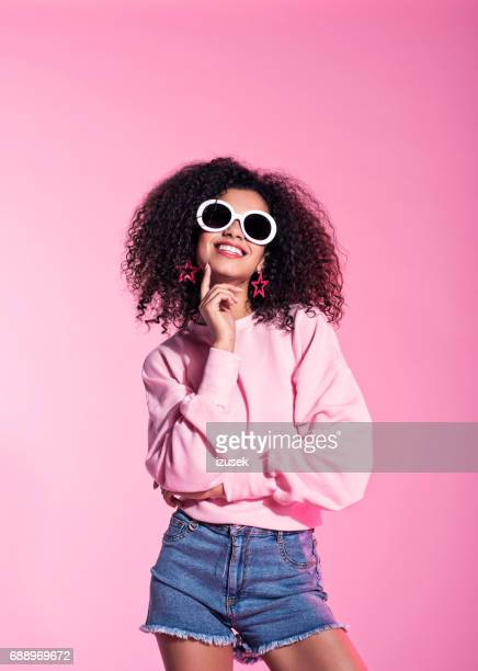 Young afro woman wearing sunglasses