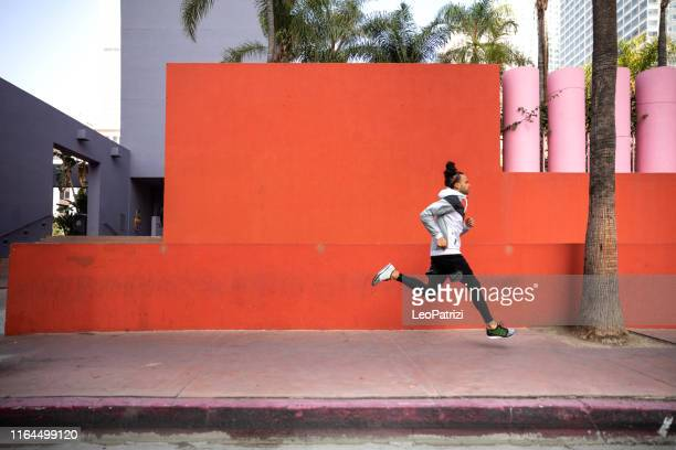 young afroamerican man getting fit in los angeles downtown city streets - los angeles città foto e immagini stock