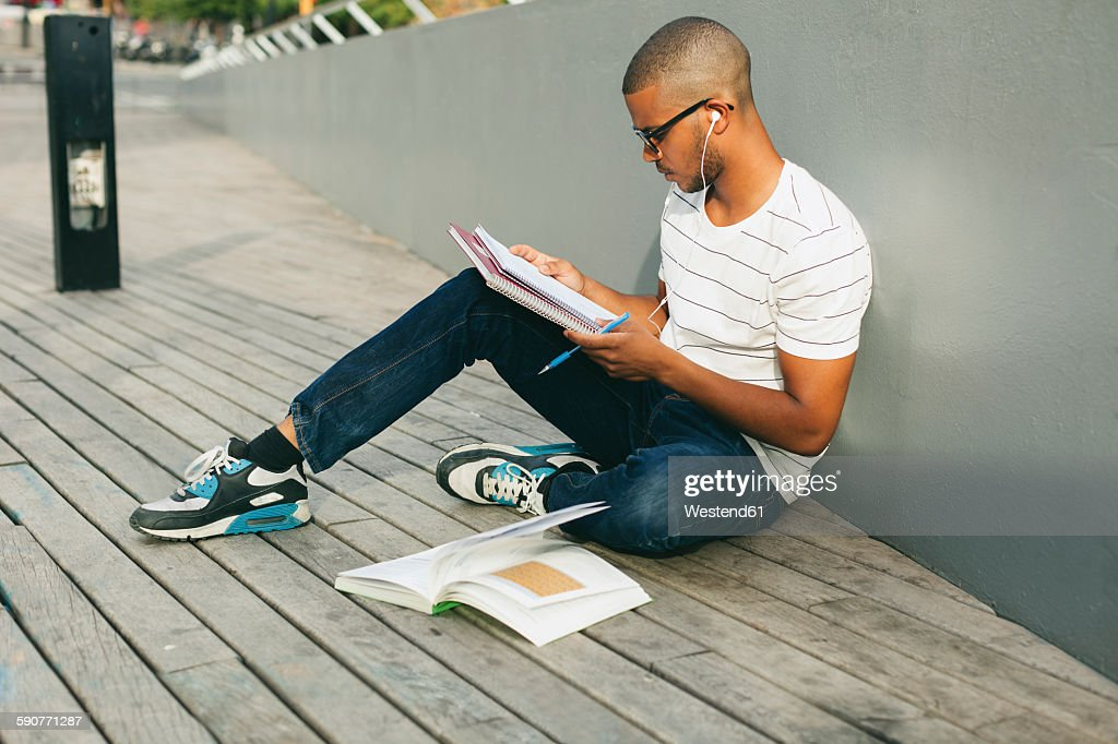 Young Afro-american man studying language : Stock Photo