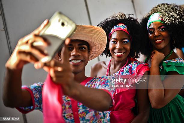 Young AfroColombians take a selfie on AfroColombian Day on May 21 in Cali Colombia celebrating the 165th anniversary of the abolition of slavery in...