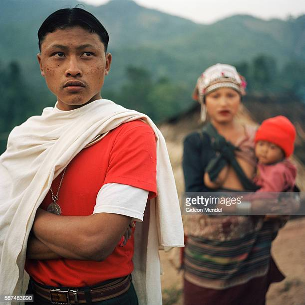 A young Akha couple with their child in the Ban Nam Lai Akha village The Akha are a hill tribe of subsistence farmers known for their artistry This...