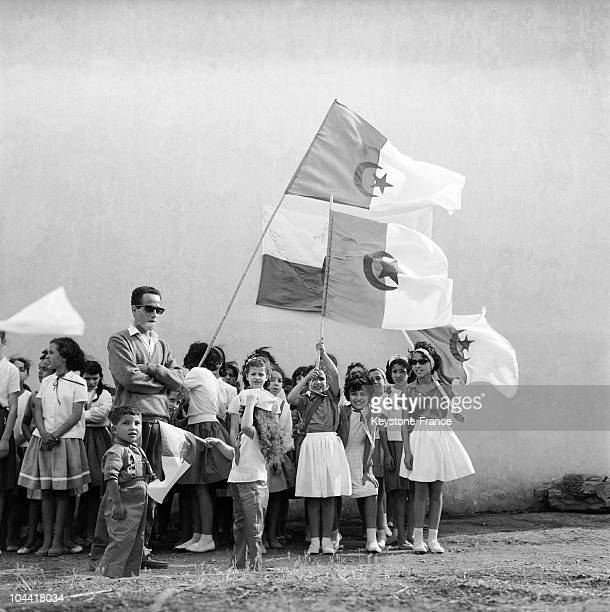 Young Algerian scouts brandishing the Algerian flag on June 30 the eve of the country's political independence
