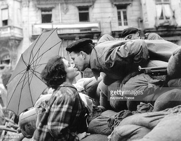 A young Algerian woman kisses a proFrench Algeria insurgent perched on one of the numerous barricades that invaded the city of Algiers between...