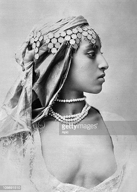 Young algerian woman wearing traditional suit, circa 1910.