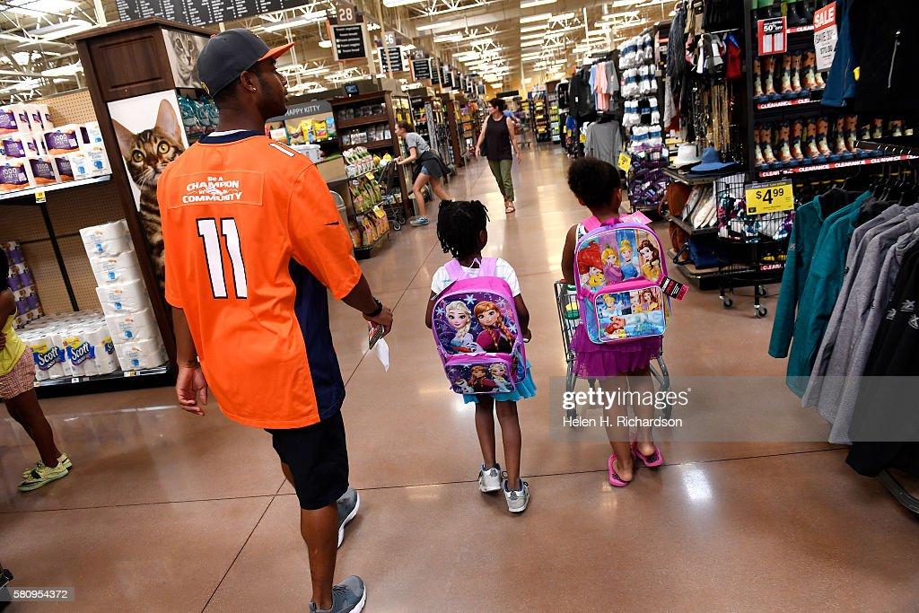 b7be99499 Denver Broncos football players shop with kids from Denver Broncos Boys   Girls  Club for school