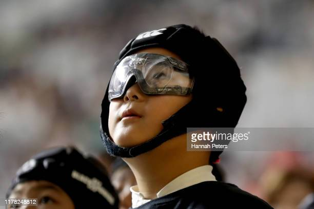Young All Blacks fan wearing goggles runs through drills with players during an All Blacks fan event at the Beepu B-Con Plaza Convention Hall on...