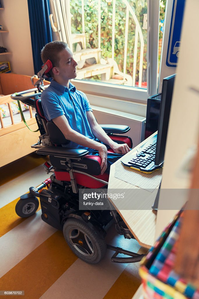 Young ALS patient gaming : Stock Photo