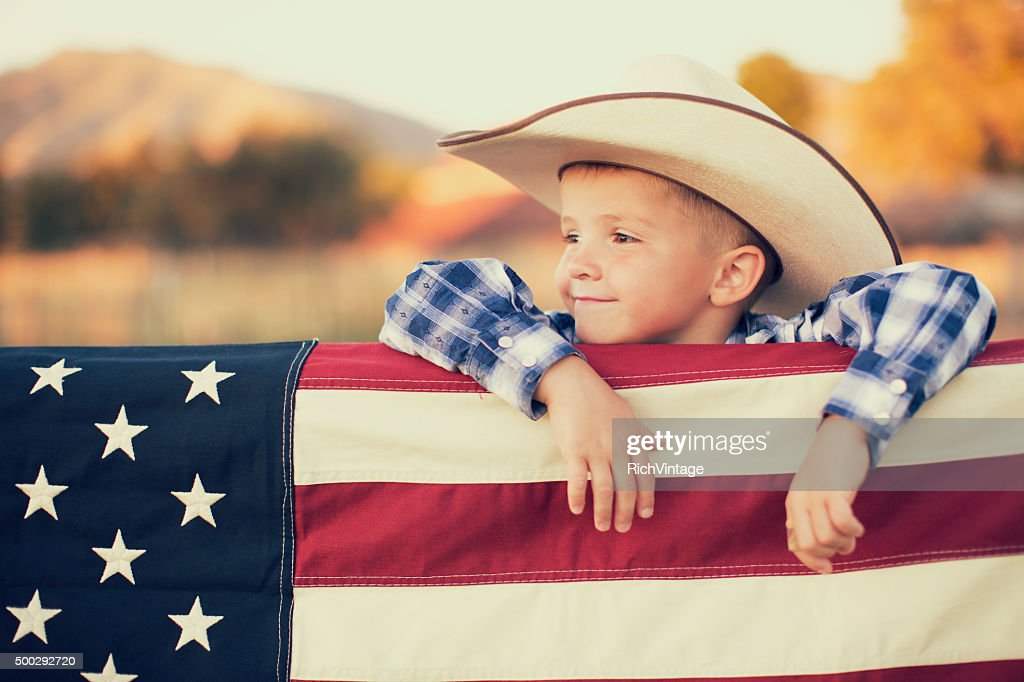 Young American Cowboy with US Flag : Stock Photo