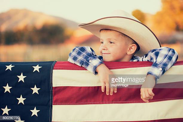 Young American Cowboy with US Flag