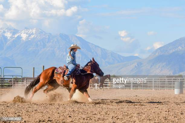 young american cowgirl practicing rodeo skills on horseback in spanish fork utah - spanish fork utah stock pictures, royalty-free photos & images
