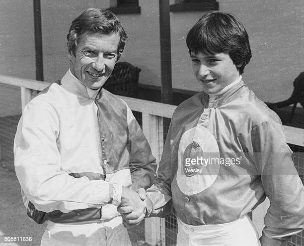 Young American jockey Steve Cauthen shaking hands with British veteran jockey Lester Piggott prior to the race at Kempton Park England April 14th 1979