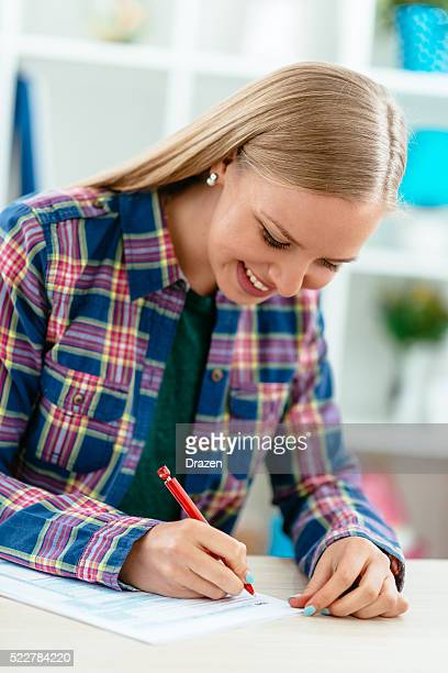young american woman in office filling out 1040 tax form - 1040 tax form stock photos and pictures