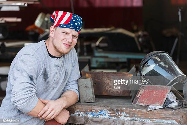 young american worker in factory - do rag stock pictures, royalty-free photos & images