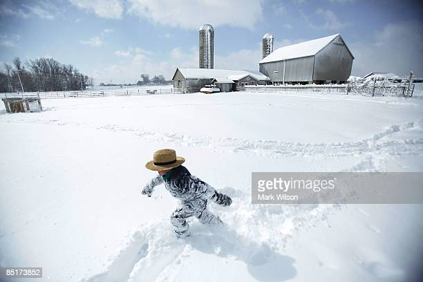 A young Amish boy plays in the snow while enjoying a day off from school due to the snow storm March 2 2009 in St Mary's County Maryland The...