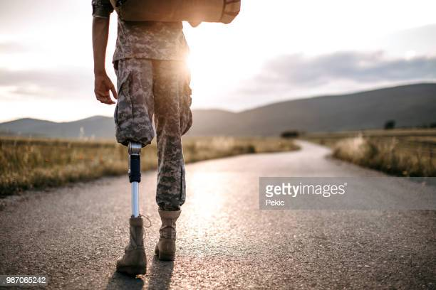 young amputee soldier coming home - injured soldier stock photos and pictures