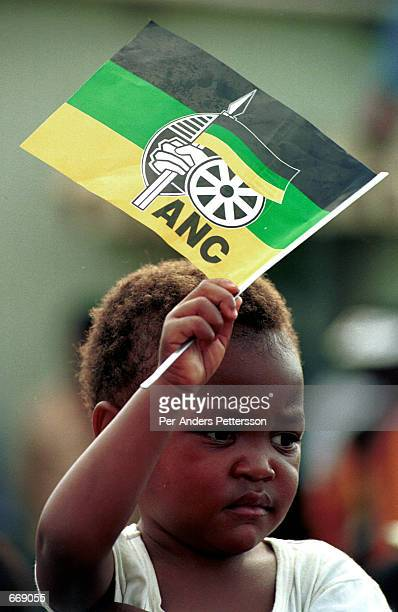 A young ANC supporter with an ANC flag waits for President Nelson Mandela to appear at an ANC rally April 11 1994 in Durban South Africa just a few...