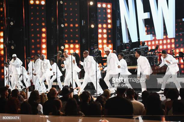 Young and adult cast members of 'The New Edition Story' and original members of New Edition perform onstage at 2017 BET Awards at Microsoft Theater...