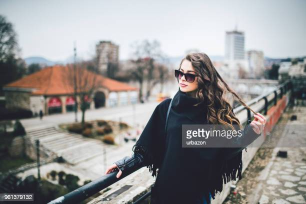 Young and attractive woman enjoying a walk in the beautiful day.