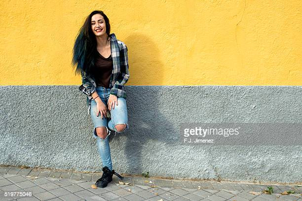 Young and beatiful girl in front of yellow wall