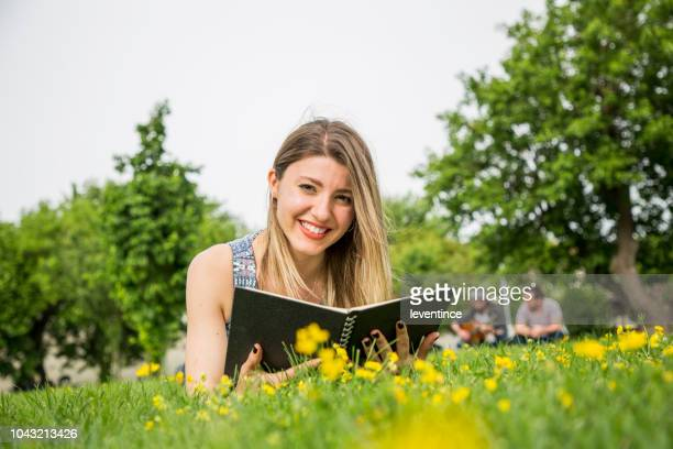 young and beautiful student with books at the campus - high school musical: the musical: the series stock photos and pictures