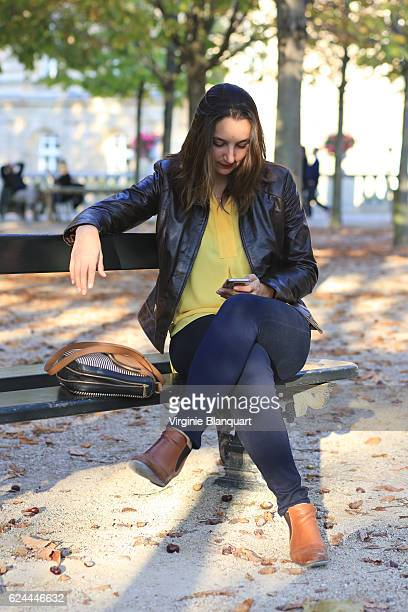 Young and beautiful stylish parisian woman in the autumn light